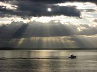 Sunlight Streams Through Clouds Over Puget Sound