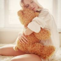 girl with teddy bear Art Prints & Posters by Aleksey Tugolukov