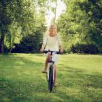 """blond girl biking"" by Alekcej"
