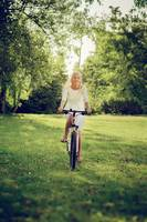 blond girl biking