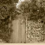 """Wood Gate in a Wall of Stones"" by rhamm"
