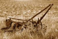 Antique Plow Abandoned in a Field