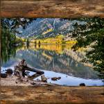"""Mountain Lake Rustic Cabin Window View"" by lightningman"