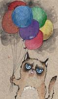 grumpy little cat with colorful balloons