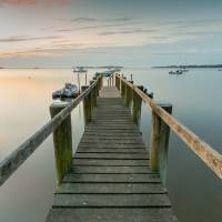 """Boat Dock at SunriseGrey Blue Panorama"" by Black_White_Photos"