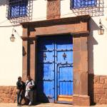 """Blue Door Street Scene Cusco Peru"" by RoupenBaker"