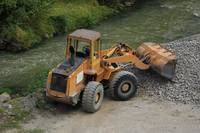 Front End Loader Next to a River