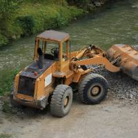 Front End Loader Next to a River Art Prints & Posters by Robert Hamm