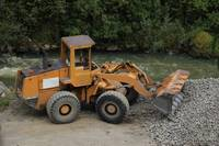 Front End Loader and Rock Pile