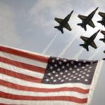 """Blue Angels soars over Old Glory as they perform t"" by motionage"