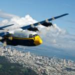 """C-130 Hercules flys over San Francisco Credit US N"" by motionage"