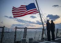 Sailors lower the ensign US Flag , US Navy