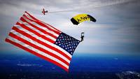 Leap Frogs skydive with an American flag