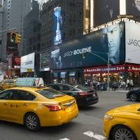 Jason Bourne ad in Times Square, New York Art Prints & Posters by Joel Carillet
