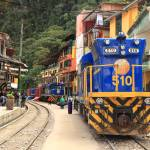 """Rail Road and Trains, Aguas Calientes, Peru"" by RoupenBaker"