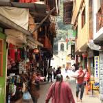 """Street Scene in Aguas Calientes Peru"" by RoupenBaker"