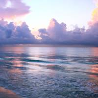 Dawn Clouds and the Caribbean Sea Art Prints & Posters by Roupen Baker