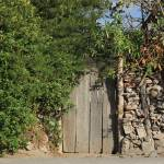 """Wood Gate in a Rock Wall"" by rhamm"