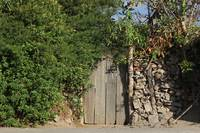 Wood Gate in a Rock Wall