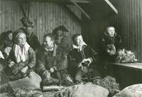 Group of sami children photographed indoors.