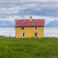 Yellow house by the sea