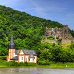 """Clemenskapelle and Burg Reichenstein"" by TomGomez"
