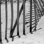 """Beach Fence Shadows Black and White"" by KsWorldArt"