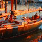 """Sunset Colors On Tall Ship Provincetown"" by dapixara"