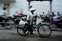 Ho Chi Minh City.Walking with a Bicycle