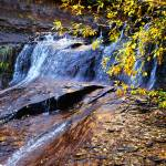 """Autumn Waterfall with Golden Leaves, Subway"" by almarphotography"
