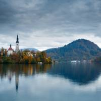 Autumn colours at Lake Bled Art Prints & Posters by Ian Middleton