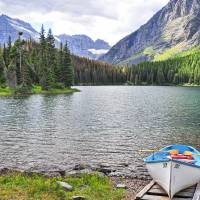 Joy on Swiftcurrent Lake (with captioning text) Art Prints & Posters by JOHN CHAO