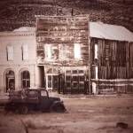 """Old Buildings with Truck Sepia"" by almarphotography"