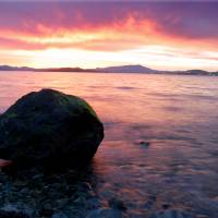 lighter sunset with rock Art Prints & Posters by Ruby Gold