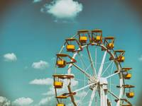 Ferris Wheel In Fun Park On Blue Sky