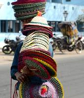 Man Covered with hats West Bengal, India