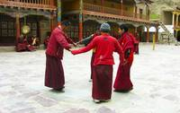 monks dance again