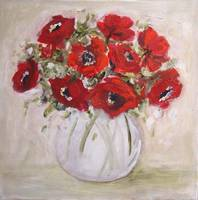 red anemones in clear vase