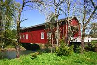 Red Covered Bridge With Apple Trees