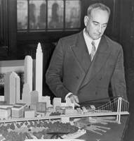 Robert Moses with a model of his proposed Battery