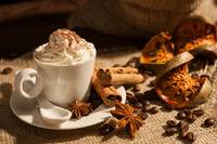 Close-up of coffee with whipped cream and cocoa po