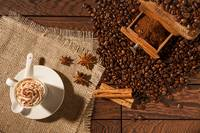 Coffee cup, star anise, cinnamon sticks and coffee