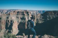 Man Wearing Cowboy Hat Looting At Grand Canyon