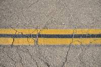Yellow Road Lines Dividing The Center Of An Old Ro