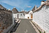 Trulli houses in a street of Alberobello