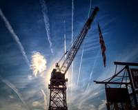 bmi-crane-backlit-by-sun-220115