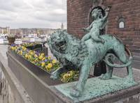 1394-boy_on_a_lion_from_Stockholm_Town_Hall