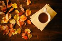 Cup of tea, books and autumnal foliage