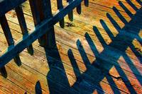 Bright Boardwalk Shadows and Glitter