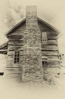 Stone chimney and timber cabin
